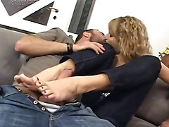Horny Woman Gets footjob  On The Couch